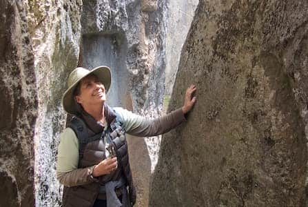 Robyn Fergus touching sacred rocks in Peru